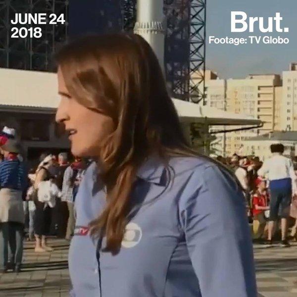 Brazilian reporter dodges football fan's kiss